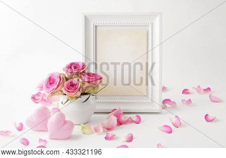 artwork frame mockup, design with pink flowers in vase, white background. This mockup frame is the perfect way to show your artwork. best for mothers day, valentines, birthday or wedding