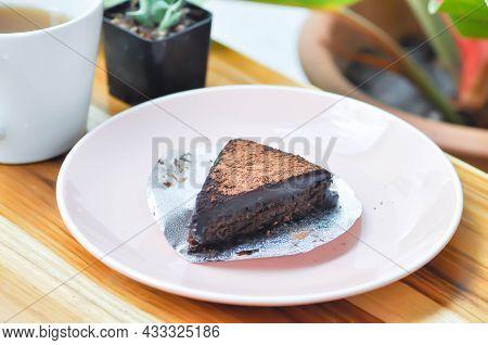 Chocolate Cake Or Dark Chocolate Cake, Brownie And Hot Drink
