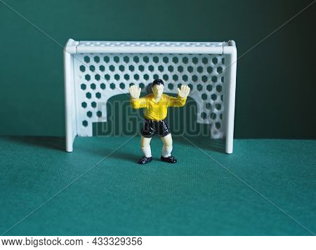 Soccer Goalkeeper, Dressed In Yellow. Game Strategy. Last Frontier. Table Football. Penalty Shot