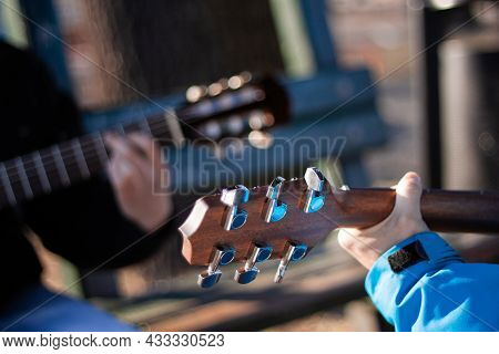 Two Men Playing A Guitar At Park Close Up   Close Back View Photo Of Two People Playing Guitar Outdo