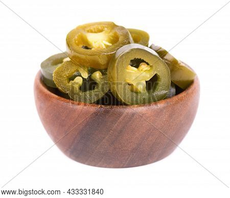 Pickled Jalapeno Pepper In Wooden Bowl, Isolated On White Background. Slices Of Preserved Hot Serran