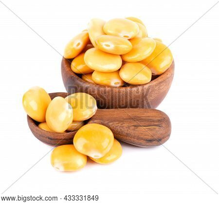 Pickled Yellow Lupine Beans In Wooden Bowl And Spoon, Isolated On White Background. Tournus, Preserv
