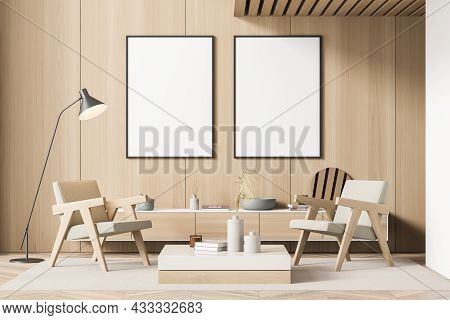 Two Canvases Over Two Armchairs, Standing In The Living Room With Beige Interior Details, A Sideboar
