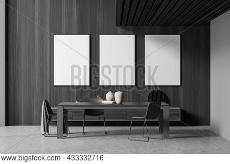 Dark Grey Living Room Interior Design With Three Empty Canvases On The Wood Wall And Three Chairs Ne