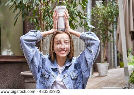 Pretty Girl Drink Beverage Outdoors. Buy Takeaway Coffee In Own Cup. Caucasian Real People. Single F