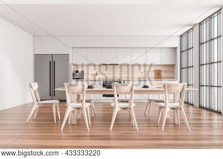 Front View On Kitchen Room Interior With Wooden Floor, Empty White Wall, Table With Chairs, Panorami