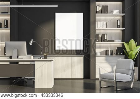 Dark Office Room Interior With Empty White Poster, Desktop, Armchairs, Black Wall, Desk, Bookshelves