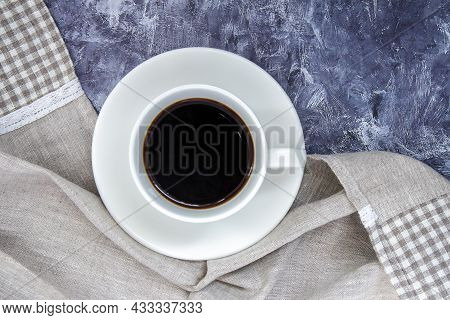 White Cup Of Black Coffee Americano And A Beautiful Shawl Made Of Fabric On A Gray Table. Beautiful