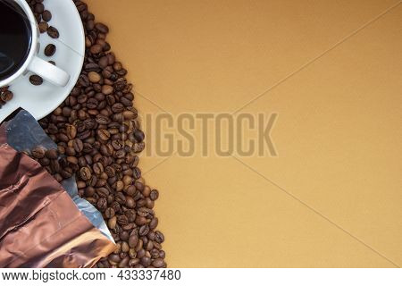 White Cup Of Americano Black Coffee Without Milk With A Bunch Of Roasted Coffee Beans Scattered From