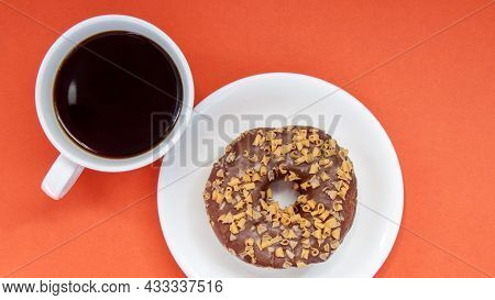One Chocolate Donut And Black Americano Coffee Without Milk In A White Cup On A Bright Background. T