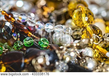 Abstract Background From Various Colorful Bright Jewelry And Costume Jewelry, Soft, Selective Focus