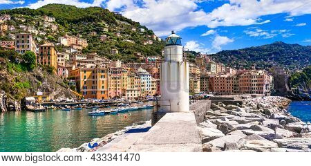 Travel in Italy, Liguria region - beautiful coastal town Camogli . panoramic view with light house and fishing boats