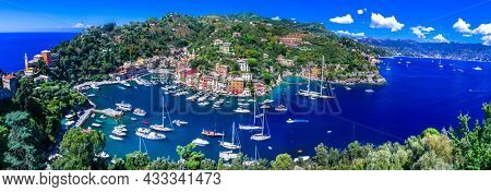 most beautiful coastal towns of Italy - luxury Portofino in Liguria, Panoramic view with colorful houses and sailing boats