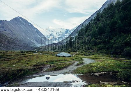 Scenic Landscape With Path To Great Snowy Mountain Peak Under Blue Sky With Clouds. Awesome Mountain