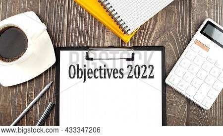 Objectives 2022 Text On Paper With Coffee, Calculator And Notebook. Business