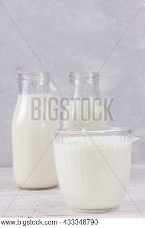 Tasty Fresh Milk On A White Wooden Background. A Glass Of Milk. Milk. Copy Space