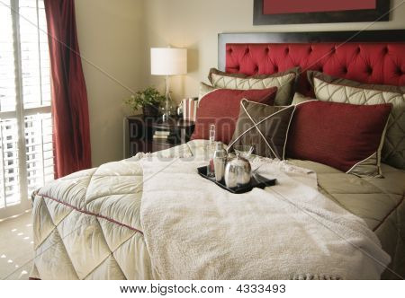 Bedroom With Lovely Red Head Board