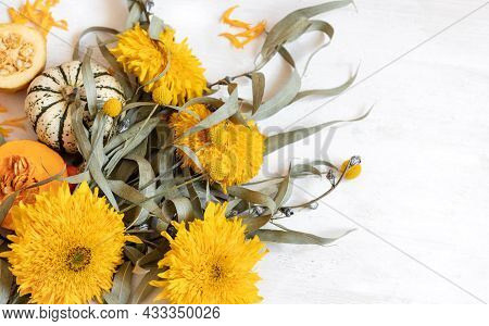 Festive Autumn Decor From Pumpkins And Flowers On A White Background, Copy Space. Concept Of Thanksg