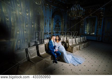 Elegant Gorgeous Bride And Stylish Groom In Amazing Old Rich Room. Luxury Wedding Concept