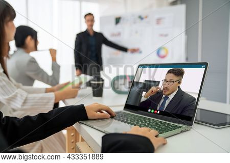Business People In Video Call Meeting Proficiently Discuss Business Plan In Office And Virual Workpl