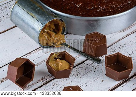 Small Mold Of Chocolate Filled With Dulce De Leche. In The Background, Roasting Pan With Brazilian H