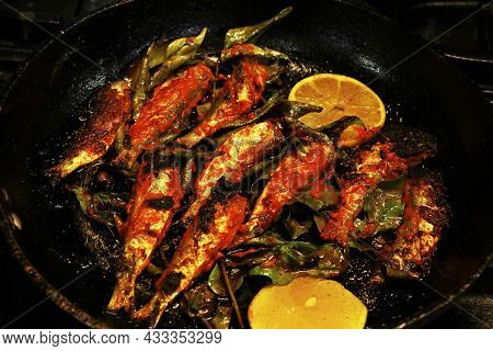 Kerala Style Masala Spiced Fish Fry, Sardine Fish In A Frying Pan.traditional Food