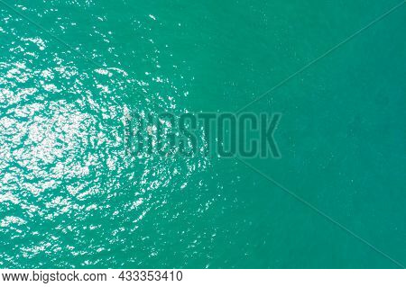 Top Down Aerial View Of Turquoise Ocean Sea Surface And Wave Texture Amazing Nature Background.