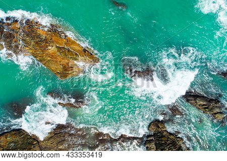 Aerial View Top Down Seashore Wave Crashing On Seashore Beautiful Turquoise Sea Surface In Sunny Day