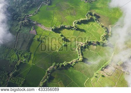 Aerial View Landscape Of Farm Land Fild In Rural Village Mountains Of Asia With Mist Fog During Morn