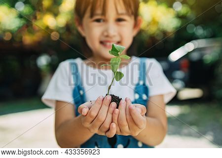 Cute Kid Planting A Tree For Help To Prevent Global Warming Or Climate Change And Save The Earth. Pi