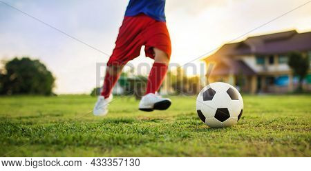 Action Sport Scene Of A Group Of Kids Having Fun Playing Soccer Football For Exercise In Community R