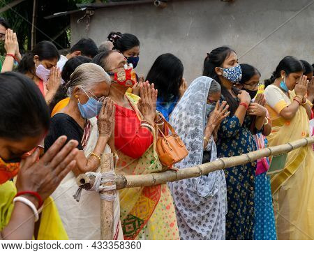 Howrah, West Bengal, India - 25th October 2020 : Masked Old Female Devotees Uttering Sanskrit Shloka