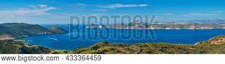 Scenic panorama of greek scenery - Aegean sea near Milos island with speeding speed boat catamaran ferry vessel on summer day in Greece
