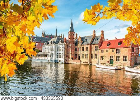 Bruges Canals And Medieval Architecture In Autumn, Belgium