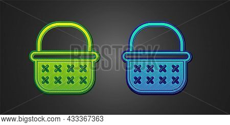Green And Blue Wicker Basket Icon Isolated On Black Background. Vector