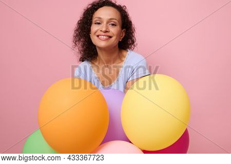 Middle Aged Friendly Cheerful African American Woman Smiles Toothy Smile Looking At Camera, Posing W