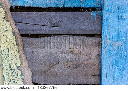 Destroyed Wooden Wall. Damaged Wood Surface. Texture Of An Old Shabby Wooden Board.