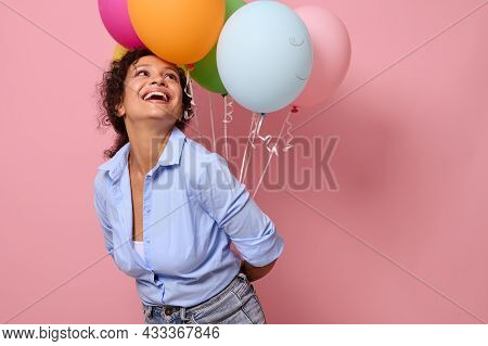 Cheerful Joyful African Young Woman In Blue Shirt Laughing And Smiling With Toothy Smile Looking Up