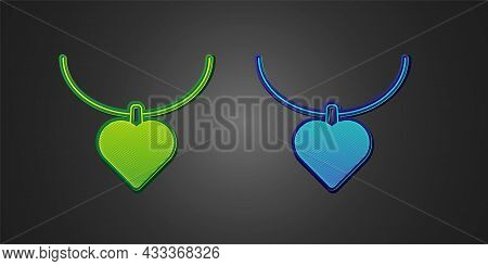 Green And Blue Necklace With Heart Shaped Pendant Icon Isolated On Black Background. Jewellery Decor