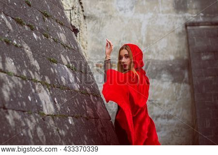 Concept Of Halloween. Beautiful And Simple Costume Of Little Red Hood. Mysterious Hooded Figure In M