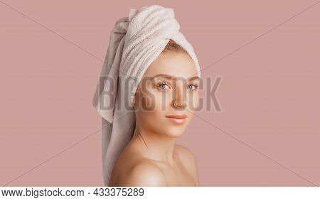Beautiful Sensual Young Girl With Clean Skin On A Pink Background With A Mockup. Topless Woman In A
