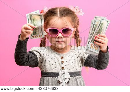 Girl Holding Paper Us Dollars, Rich And Happy Child, Child And Money.