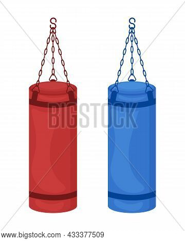 Two Large Cylindrical Punching Bags Of Red And Blue Colors. Sports Equipment For Boxing, Kickboxing