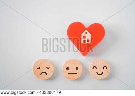 Wooden Miniature House On Red Heart Shape With Emotion Icon On Circle Wood , Wellness, Wellbeing, Ho