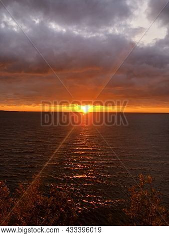 Sun Setting Over The Baltic Ocean With Clouds