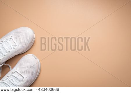 Flat Lay Sport With White Sport Shoes On Pink Background. Concept Healthy Lifestyle, Sport And Diet