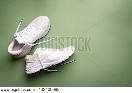 Flat Lay Sport With White Sport Shoes On Green Background. Concept Healthy Lifestyle, Sport And Diet