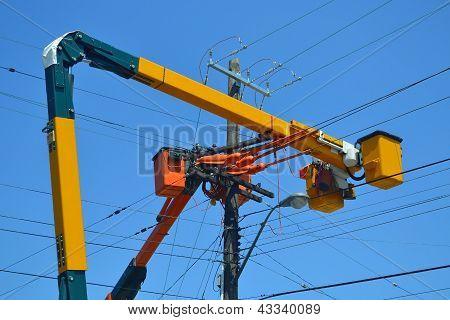 Lift Trucks On Power Lines.