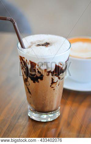Chocolate Or Iced Chocolate, Iced Coco Or Mocha Coffee On The Table