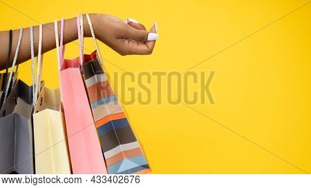Shopping Banner. Black Friday. Sale Flyer. Closeup Of African Woman Hand With Shopper Paper Bags Iso